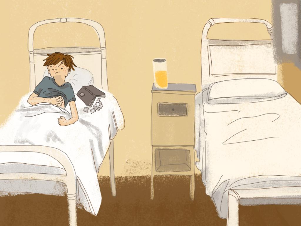 Papelucho está acostado en la cama de la enfermería.