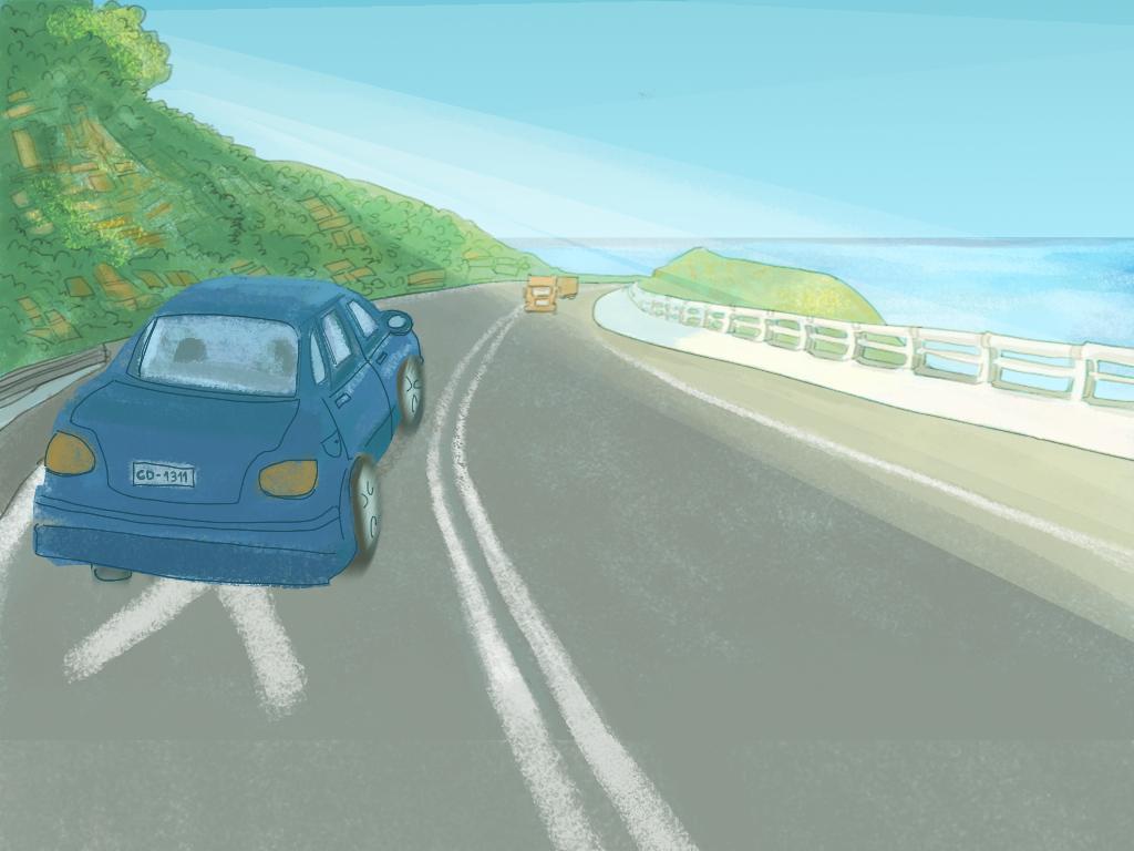 Un auto va por la carretera en dirección a la playa
